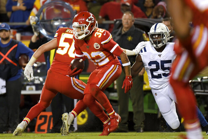 Kansas City Chiefs safety Tyrann Mathieu (32) intercepts a pass intended for Indianapolis Colts running back Marlon Mack (25) during the first half of an NFL football game in Kansas City, Mo., Sunday, Oct. 6, 2019. (AP Photo/Reed Hoffmann)