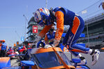 Scott Dixon, of New Zealand, climbs into his car during a practice session for the Indianapolis 500 auto race at Indianapolis Motor Speedway, Thursday, Aug. 13, 2020, in Indianapolis. (AP Photo/Darron Cummings)
