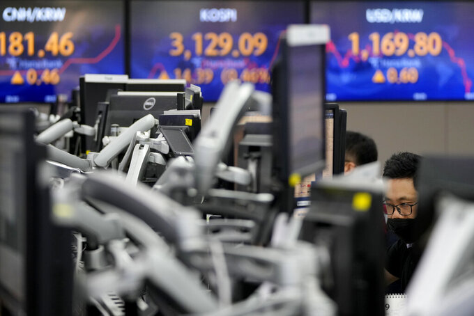 A currency trader watches computer monitors at the foreign exchange dealing room in Seoul, South Korea, Friday, Sept. 10, 2021. Shares were higher in Asia on Friday as investors stepped up buying despite another decline on Wall Street that kept the S&P 500 and the Nasdaq on track for their first weekly losses in three weeks.(AP Photo/Lee Jin-man)