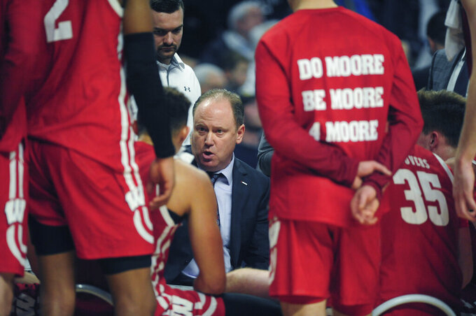Wisconsin coach Greg Gard talks to his players during a time out late in the second half of an NCAA college basketball game with Penn State, Saturday, Jan. 11, 2020, in State College, Pa. (AP Photo/Gary M. Baranec)