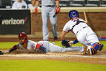 St. Louis Cardinals' Edmundo Sosa slides past New York Mets catcher James McCann to score on a Harrison Bader two-run single during the first inning of a baseball game Wednesday, Sept. 15, 2021, in New York. (AP Photo/Frank Franklin II)