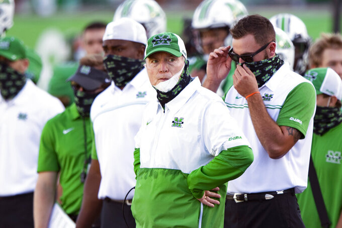 FILE - Marshall NCAA college football head coach Doc Holliday stands on the sidelines during a game against  Appalachian State in Huntington, W.Va., in this Saturday, Sept. 19, 2020, file photo. Marshall announced Monday, Jan. 4, 2021, that it will not renew the contract of coach Doc Holliday. (AP Photo/Emilee Chinn, File)