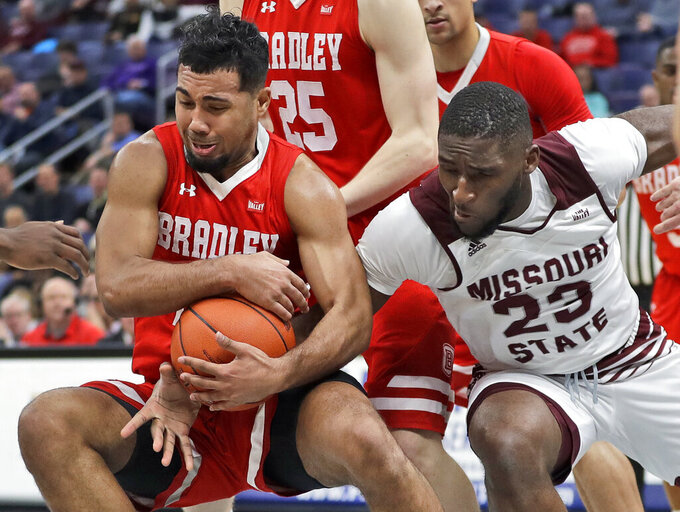 Bradley's Dwayne Lautier-Ogunleye, left, and Missouri State's Kabir Mohammed wrestle over the ball during the first half of an NCAA college basketball game in the quarterfinal round of the Missouri Valley Conference tournament, Friday, March 8, 2019, in St. Louis. (AP Photo/Jeff Roberson)