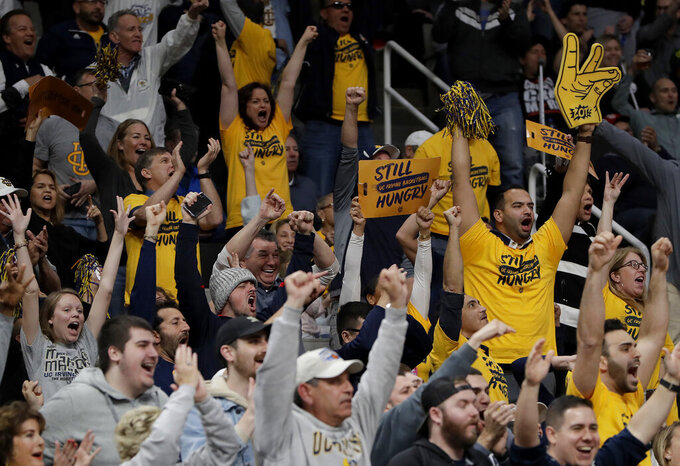 UC Irvine fans cheer during the second half a first-round game against Kansas State in the NCAA men's college basketball tournament Friday, March 22, 2019, in San Jose, Calif. (AP Photo/Chris Carlson)