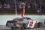 Myatt Snider stands on his car after winning the NASCAR Xfinity Series auto race Saturday, Feb. 27, 2021, at Homestead- Miami Speedway in Homestead, Fla. (AP Photo/Wilfredo Lee)
