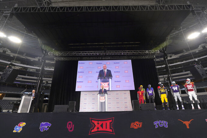 CORRECTS DATELINE TO ARLINGTON, TEXAS, NOT DALLAS AS ORIGINALLY SENT - Big 12 commissioner Bob Bowlsby, center, speaks during NCAA college football Big 12 media days Wednesday, July 14, 2021, in Arlington, Texas. (AP Photo/LM Otero)
