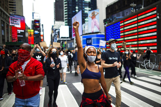 Protesters chant during a solidarity march for George Floyd, Tuesday, June 2, 2020, in Times Square, New York. George Floyd died after being restrained by Minneapolis police officers on May 25. (AP Photo/Eduardo Munoz Alvarez)