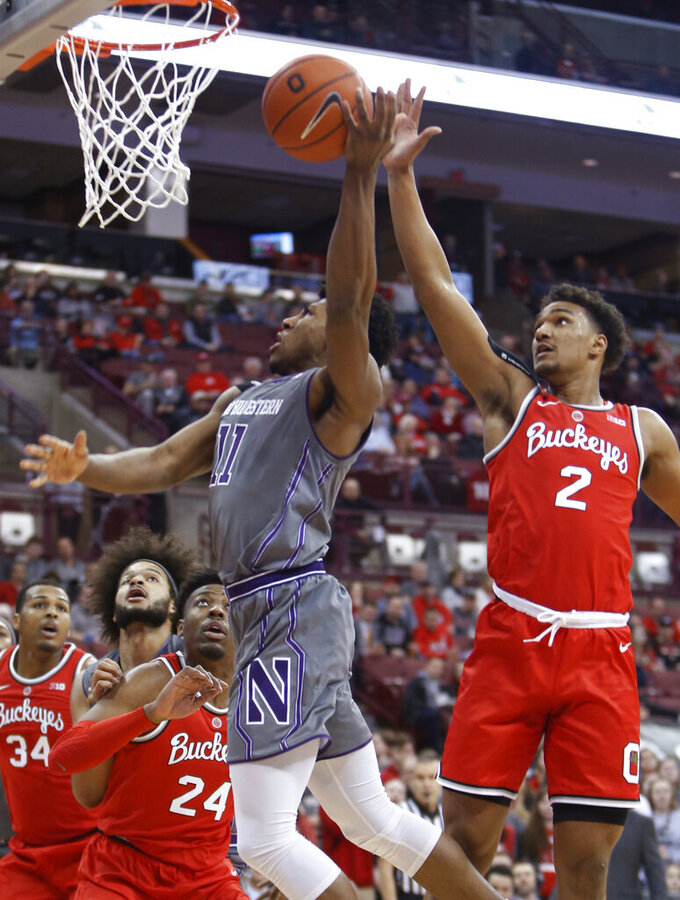 Northwestern's Anthony Gaines, center, takes a shot between Ohio State's Andre Wesson, left, and Musa Jallow during the first half of an NCAA college basketball game Wednesday, Feb. 20, 2019, in Columbus, Ohio. (AP Photo/Jay LaPrete)