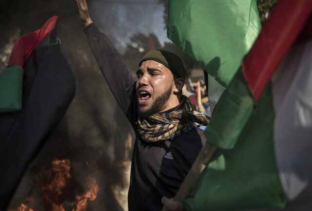 Palestinian protesters chant angry slogans during a protest against the U.S. Mideast peace plan, in Gaza City, Monday, Jan. 28, 2020. U.S. President Donald Trump is set to unveil his administration's much-anticipated Mideast peace plan in the latest U.S. venture to resolve the Israeli-Palestinian conflict. (AP Photo/Khalil Hamra)