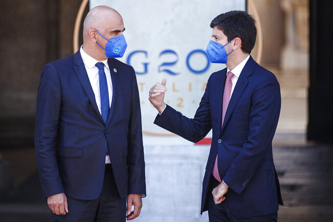Swiss Health Minister Alain Berset, left, and Italian Minister Roberto Speranza share a word at the start of a G20 meeting in Rome, Saturday, Sept. 5, 2021.  (Roberto Monaldo/LaPresse via AP)