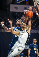 Georgia Tech forward Rodney Howard (24) blocks a shot from Wake Forest guard Jalen Johnson (2) during an NCAA college basketball game Friday, March 5, 2021, in Winston-Salem, N.C. (Andrew Dye/The Winston-Salem Journal via AP)