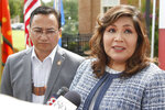 Kimberly Teehee, right, answers a question for the media as Cherokee Nation Principal Chief Chuck Hoskin Jr., left, looks on, following his announcement that he is nominating Teehee as a Cherokee Nation delegate to the U.S. House, in Tahlequah, Okla., Thursday, Aug. 22, 2019. Hoskin Jr. acknowledged the first such attempt by a tribal nation will take time as well as cooperation from Congress. (AP Photo/Sue Ogrocki)