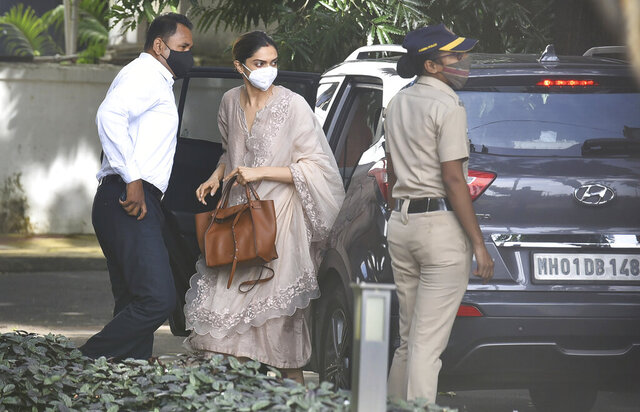 Bollywood actor, Deepika Padukone, center, arrives at the office of narcotics control board, in Mumbai, India, Saturday, Sept. 26, 2020. Bollywood star, Deepika Padukone, was questioned on Saturday by India's narcotics control board which is probing the movie industry's links with drug peddler and cartels, officials said. (AP Photo)