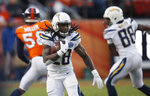 FILE - In this Dec. 30, 2018, file photo, Los Angeles Chargers running back Melvin Gordon rushes during the second half of the team's NFL football game against the Denver Broncos in Denver. A person familiar with the situation says Gordon will end his holdout and report to the Los Angeles Chargers on Thursday, Sept. 26. The person spoke to The Associated Press on condition of anonymity Wednesday because he wasn't at liberty to publicly discuss the situation. (AP Photo/David Zalubowski, File)