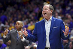 Mississippi head coach Kermit Davis reacts to a call on one of his players in the first half of an NCAA college basketball game against LSU, Saturday, Feb. 1, 2020, in Baton Rouge, La. (AP Photo/Bill Feig)