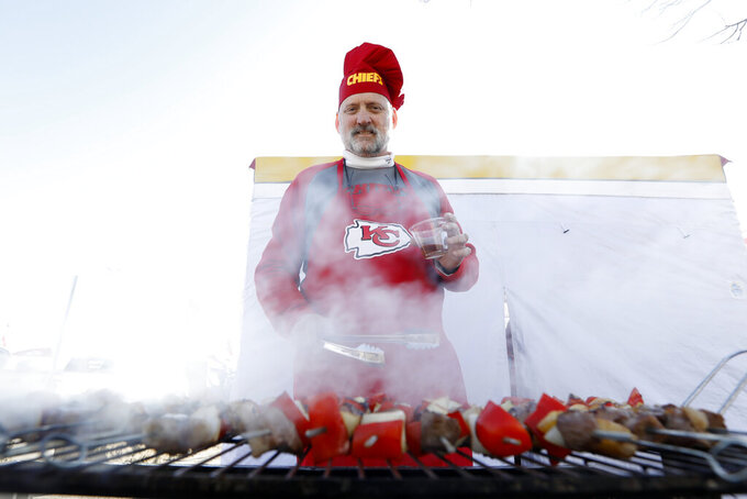 Patrick Morries tailgates before the NFL AFC Championship football game between the Kansas City Chiefs and the Tennessee Titans Sunday, Jan. 19, 2020, in Kansas City, MO. (AP Photo/Charlie Neibergall)