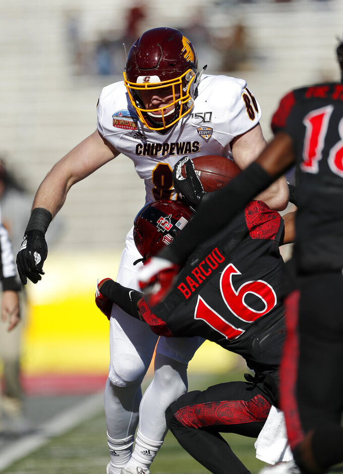 Central Michigan tight end Bernhard Raimann (86) is sacked by San Diego State cornerback Luq Barcoo (16) during the first half of the New Mexico Bowl NCAA college football game on Saturday, Dec. 21, 2019 in Albuquerque, N.M. (AP Photo/Andres Leighton)