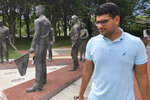 In this June 26, 2019 photo, Ashish Bibireddy, 23, tours a war memorial at Cumberland Square Park in Bristol, Va. Ten medical students were on a tour of the city organized by a medical school with the aim of luring them to practice in rural communities facing health care shortages after graduation. (AP Photo/Sudhin Thanawala)
