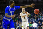 Notre Dame's Matt Farrell (5) dishes out a pass against Hampton during an NCAA college basketball game in the first round of the NIT tournament, Tuesday, March 13, 2018, in South Bend, Ind.   (Michael Caterina/South Bend Tribune via AP)