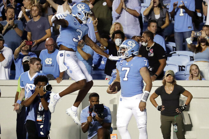 North Carolina quarterback Sam Howell (7) celebrates his touchdown run with wide receiver Antoine Green (3) during the first half of an NCAA college football game in Chapel Hill, N.C., Saturday, Sept. 11, 2021. (AP Photo/Chris Seward)