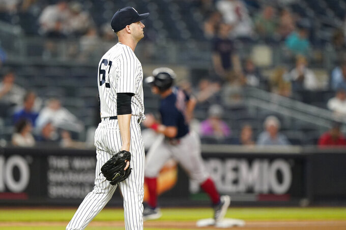 New York Yankees relief pitcher Lucas Luetge (63) reacts as Boston Red Sox Marwin Gonzalez runs the bases after hitting a game-tying, two-run, home run during the sixth inning of a baseball game Sunday, June 6, 2021, at Yankee Stadium in New York. (AP Photo/Kathy Willens)