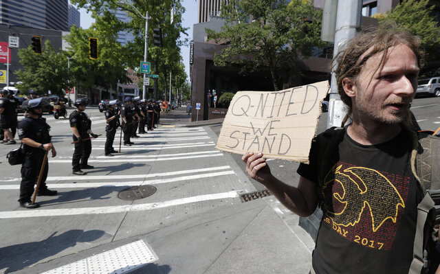 In this Aug. 18, 2018 file photo man holds a sign that reads