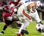 Alabama defensive lineman Tim Smith (50) hits Auburn quarterback Bo Nix (10) during an NCAA college football game Saturday, Nov. 28, 2020, in Tuscaloosa, Ala. (Mickey Welsh/The Montgomery Advertiser via AP)