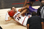 Texas Tech's Marcus Santos-Silva (14) dives to keep the ball away from Abilene Christian's Reggie Miller during the first half of an NCAA college basketball game Wednesday, Dec. 9, 2020, in Lubbock, Texas. (AP Photo/Brad Tollefson)