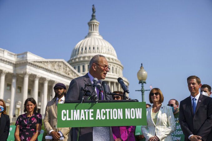 Senate Majority Leader Chuck Schumer, D-N.Y., addresses the urgent need to counter climate change in the US with transformational investments in clean jobs, during an event at the Capitol in Washington, Wednesday, July 28, 2021. (AP Photo/J. Scott Applewhite)