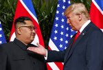 FILE - In this June 12, 2018, file photo, U.S. President Donald Trump, right, meets with North Korean leader Kim Jong Un on Sentosa Island in Singapore. With their second summit fast approaching, speculation is growing that Trump may try to persuade Kim to commit to denuclearization by giving him something he wants more than almost anything else, an announcement of peace and an end to the Korean War. (AP Photo/Evan Vucci, File)
