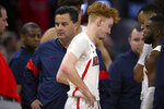 Arizona coach Sean Miller, left, and guard Nico Mannion react at the end of the team's NCAA college basketball game against St. John's on Saturday, Dec. 21, 2019, in San Francisco. St. John's won 70-67. (AP Photo/D. Ross Cameron)