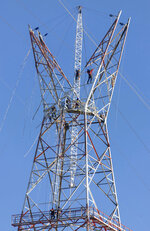 Technicians continue dismantling Tower 412 to replace it with a new tower in the Litoral corredor near the town of Zarate, on the border of Buenos Aires and Entre Rios provinces, Argentina, Wednesday, June 19, 2019. Located in the Parana River, Tower 412 hasn't been operational since April while workers built its replacement, and a bypass system had been set up to handle the current. Argentina's government suggested the origin of Sunday's blackout may stem from this corredor, and hopes to give a detailed explanation of events in twelve days time once all the technical elements have been analyzed. (AP Photo/Tomas F. Cuesta)