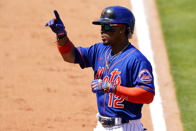 New York Mets' Francisco Lindor (12) reacts after hitting a two-run home run during the sixth inning of a spring training baseball game against the Houston Astros, Tuesday, March 16, 2021, in Port St. Lucie, Fla. (AP Photo/Lynne Sladky)