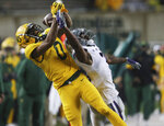 Baylor wide receiver R.J. Sneed, left, pulls in a long pass over Kansas State defensive back Kiondre Thomas, right, in the second half of an NCAA college football game, Saturday, Nov. 28, 2020, in Waco, Texas. (Rod Aydelotte/Waco Tribune-Herald via AP)