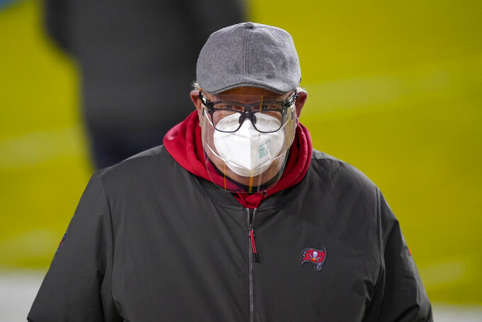 Tampa Bay Buccaneers head coach Bruce Arians walks on the field before the team's NFL wild-card playoff football game against the Washington Football Team, Saturday, Jan. 9, 2021, in Landover, Md. (AP Photo/Andrew Harnik)