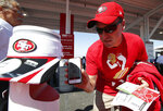 FILE - In this Aug. 17 2014, file photo, a fan uses a smart phones to scan tickets at Levi's Stadium before an NFL preseason football game between the San Francisco 49ers and the Denver Broncos in Santa Clara, Calif. Tickets have widely transitioned from paper souvenirs to smartphone screens. These tools are an important piece of the reopening puzzle. They also further test a fan's willingness to potentially sacrifice a little more privacy in an increasingly wired-in world in exchange for the opportunity to sit courtside or behind the plate again. (AP Photo/Tony Avelar, File)