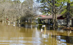 Water floods the street of Canton Club Circle subdivision in northeast Jackson, Miss., Saturday, Feb. 15, 2020. Cam Bonelli/Hattiesburg American via AP)