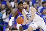 Creighton's Mitch Ballock (24) passes the ball in front of DePaul's Romeo Weems (1) during the first half of an NCAA college basketball game in Omaha, Neb., Saturday, Feb. 15, 2020. (AP Photo/Nati Harnik)