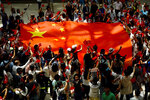 Pro-China protesters wave a Chinese national flag at a shopping mall in Hong Kong, Friday, Sept. 13, 2019. Protest-related activities are expected to continue Friday, when Chinese celebrate the Mid-Autumn Festival with lanterns and mooncakes. Police banned a planned major march in central Hong Kong on Sunday, but many protesters have said they will turn up anyway. (AP Photo/Vincent Yu)