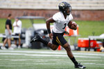 Missouri running back Tyler Badie runs with the ball during an NCAA college football practice Monday, Aug. 12, 2019, in Columbia, Mo. (AP Photo/Jeff Roberson)