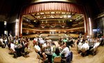 In this Aug. 4, 2019 photo, Chef Anthony and Amanda Felan's Second Act Supper Club has a dinner on the stage at the Shreveport Municipal Auditorium in Shreveport, La. Anthony Felan learned an invaluable lesson after graduating from Le Cordon Bleu culinary institute and working on the ground-level of San Francisco's dining scene: If you're not invited to the exclusive, secret dinner parties, throw your own.  (Henrietta Wildsmith/The Shreveport Times via AP)