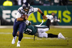 Seattle Seahawks' Russell Wilson (3) rushes past Philadelphia Eagles' Nigel Bradham (53) during the second half of an NFL wild-card playoff football game, Sunday, Jan. 5, 2020, in Philadelphia. (AP Photo/Chris Szagola)