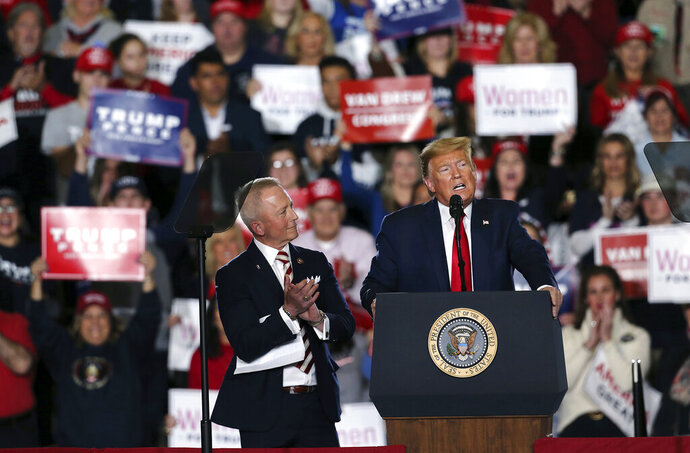 President Donald Trump speaks at a campaign rally Tuesday, Jan. 28, 2020, in Wildwood, N.J., as Rep. Jeff Van Drew, R-N.J., listens. (AP Photo/Mel Evans)