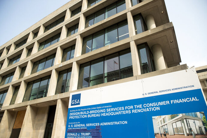 FILE- In this Aug. 27, 2018, file photo a sign stands at the construction site for the Consumer Financial Protection Bureau's headquarters in Washington. The Supreme Court is stepping into a years-long, politically charged fight over the federal consumer finance watchdog agency that was created in the wake of the 2008 financial crisis. The justices agreed Oct. 18, 2019, to review an appeals court decision that upheld the structure of the Consumer Financial Protection Bureau. (AP Photo/Andrew Harnik, File)