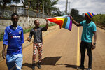 In this photo taken Friday, May 17, 2019, Ali Djabiri, an LGBT refugee from Congo, center-left, joins other LGBT refugees and their supporters living in Kenya at a protest against their treatment by authorities, outside an office of the UN refugee agency UNHCR in Nairobi, Kenya. Kenya's High Court is due to rule Friday, May 24, 2019 on whether laws that criminalize same sex relations are unconstitutional. (AP Photo/Ben Curtis)