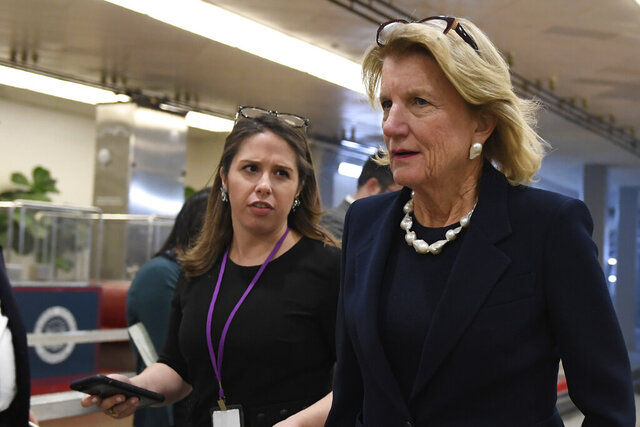 Rep. Shelley Moore Capito, R-W.Va., walks on Capitol Hill in Washington, Tuesday, Dec. 17, 2019. (AP Photo/Susan Walsh)