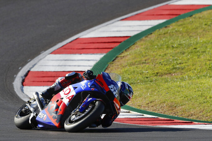 MotoGP rider Miguel Oliveira of Portugal steers his motorcycle during the MotoGP race of the Portuguese Motorcycle Grand Prix, the last race of the season, at the Algarve International circuit near Portimao, Portugal, Sunday, Nov. 22, 2020. (AP Photo/Armando Franca)