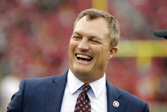 FILE - In this Jan. 19, 2020, file photo, San Francisco 49ers general manager John Lynch laughs before the NFC Championship NFL football game against the Green Bay Packers in Santa Clara, Calif. Lynch has agreed to a new five-year contract with the San Francisco 49ers that will keep him locked up through the 2024 season. (AP Photo/Marcio Jose Sanchez, File)