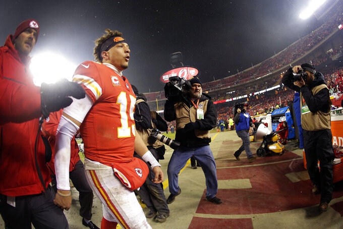 Kansas City Chiefs quarterback Patrick Mahomes (15) walks off the field after an NFL divisional football playoff game against the Indianapolis Colts Saturday, Jan. 12, 2019, in Kansas City, Mo. The Chiefs won 31-13. (AP Photo/Charlie Riedel)