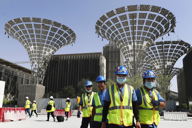 "FILE - In this Oct. 8, 2019, file photo, technicians walk at the three thematic districts at the under construction site of the Expo 2020 in Dubai, United Arab Emirates. The United States, on Wednesday, Jan. 15, 2020, said its participation at this year's World's Fair in Dubai is being made possible by ""the generosity of the Emirati government."" (AP Photo/Kamran Jebreili)"
